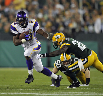 GREEN BAY, WI - OCTOBER 24:  Adrian Peterson #28 of the Minnesota Vikings runs upfield as Charlie Peprah #26 of the Green Bay Packers misses the tackle at Lambeau Field on October 24, 2010 in Green Bay, Wisconsin. (Photo by Jim Prisching/Getty Images)