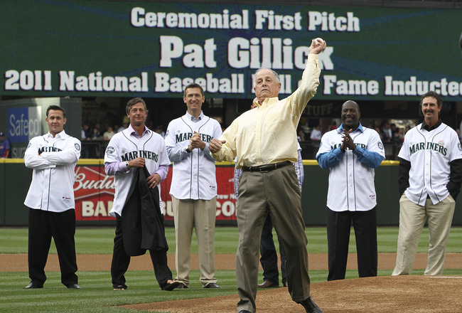 SEATTLE - JULY 16:  Former Seattle Mariners general manager Pat Gillick throws out the ceremonial first pitch prior to the game against the Texas Rangers at Safeco Field on July 16, 2011 in Seattle, Washington. Members of the 2001 Mariners team stand behi