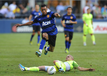 SEATTLE, WA - JULY 20: Nani #17 of Manchester United leaps over a sliding Osvaldo Alonso #6 during the first half of the game at CenturyLink Field on July 20, 2011 in Seattle, Washington. (Photo by Steve Dykes/Getty Images)