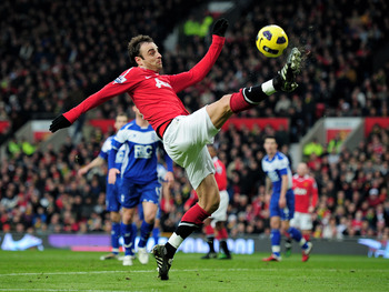 MANCHESTER, ENGLAND - JANUARY 22:  Dimitar Berbatov of Manchester United in action during the Barclays Premier League match between Manchester United and Birmingham City at Old Trafford on January 22, 2011 in Manchester, England.  (Photo by Shaun Botteril