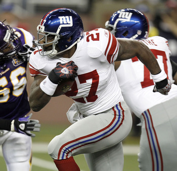 DETROIT, MI - DECEMBER 13:  Brandon Jacobs #27 of the New York Giants tries to outrun the tackle of E.J. Henderson #56 of the Minnesota Vikings at Ford Field on December 13, 2010 in Detroit, Michigan.  (Photo by Gregory Shamus/Getty Images)
