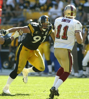 PITTSBURGH - SEPTEMBER 23: Aaron Smith #91 of the Pittsburgh Steelers pressures Alex Smith #11 of the San Francisco 49ers at Heinz Field September 23, 2007 in Pittsburgh, Pennsylvania. Pittsburgh won 36-17. (Photo by Rick Stewart/Getty Images)