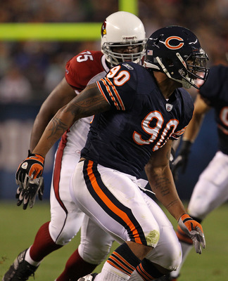 CHICAGO - AUGUST 28: Julius Peppers #90 of the Chicago Bears rushes past Levi Brown #75 of the Arizona Cardinals during a preseason game at Soldier Field on August 28, 2010 in Chicago, Illinois. The Cardinals defeated the Bears 14-9. (Photo by Jonathan Da
