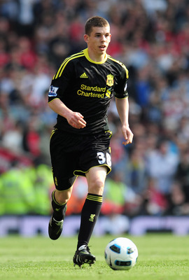 LONDON, ENGLAND - APRIL 17:  John Flanagan of Liverpool runs with the ball during the Barclays Premier League match between Arsenal and Liverpool at the Emirates Stadium on April 17, 2011 in London, England.  (Photo by Shaun Botterill/Getty Images)