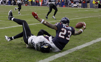 HOUSTON - JANUARY 02:  Running back Arian Foster #23 of the Houston Texans scores as he is tackled by Courtney Greene #36 of the Jacksonville Jaguars at Reliant Stadium on January 2, 2011 in Houston, Texas.  (Photo by Bob Levey/Getty Images)