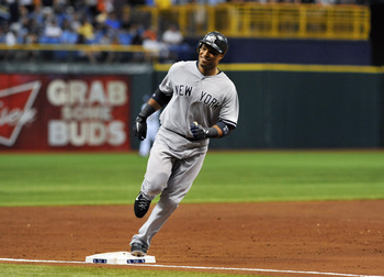 ST. PETERSBURG, FL - July 19:  Infielder Robinson Cano #24 of the New York Yankees rounds third base after a home run in the third inning against the Tampa Bay Rays July 19, 2011 at Tropicana Field in St. Petersburg, Florida.  (Photo by Al Messerschmidt/G