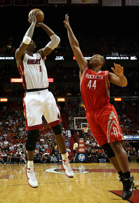 MIAMI, FL - MARCH 27:  Forward Chris Bosh #1 of the Miami Heat shoots against Center Vhuck Hayes #44 the Houston Rockets  at American Airlines Arena on March 27, 2011 in Miami, Florida. Miami defeated the Rockets 125-119. NOTE TO USER: User expressly ackn
