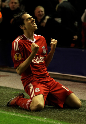 LIVERPOOL, ENGLAND - APRIL 29:  Yossi Benayoun of Liverpool celebrates scoring his team's second goal during the UEFA Europa League Semi-Final Second Leg match between Liverpool and Atletico Madrid at Anfield on April 29, 2010 in Liverpool, England.  (Pho