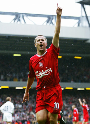 LIVERPOOL - OCTOBER 25:  Michael Owen of Liverpool celebrates scoring during the FA Barclaycard Premiership match between Liverpool and Leeds on October 25, 2003 at Anfield in Liverpool, England.  Liverpool won the match 3-1.  (Photo by Shaun Botterill/Ge