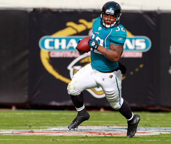 JACKSONVILLE, FL - DECEMBER 12:  Maurice Jones-Drew #32 of the Jacksonville Jaguars runs for yardage during the game against the Oakland Raiders during the game at EverBank Field on December 12, 2010 in Jacksonville, Florida.  (Photo by Sam Greenwood/Gett