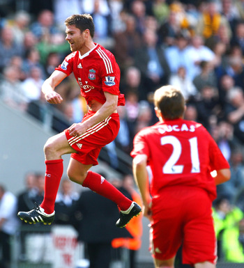 HULL, UNITED KINGDOM - APRIL 25:  Xabi Alonso of Liverpool jumps for joy as he celebrates the opening goal during the Barclays Premier League match between Hull City and Liverpool at the KC Stadium on April 25, 2009 in Hull, England.  (Photo by Laurence G