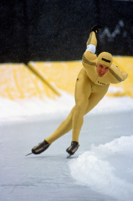 LAKE PLACID, NY - FEBRUARY 1980:  US speed skater Eric Heiden makes his way around a bend tucking low with both arms behind his back during the1980 Winter Olympic games in February 1980 in Lake Placid, New York. Eric Heiden wins first place in all five sp
