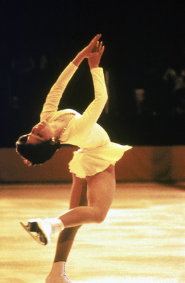 INNSBRUCK, AUS - 1976:  Dorothy Hamill skates on her left leg only with back arched and arms held high in front during the Winter Olympics skating competition in 1976 in Innsbruck,  Austria. Dorothy Hamill wins the gold medel for the USA in the Womes Figu