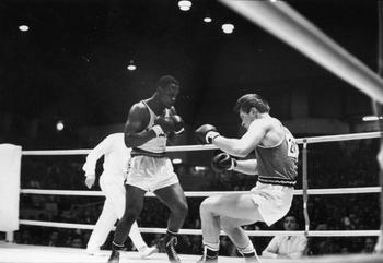 http://media.olympics.com.au/files/aocMedia/aocImage/imageHiRes/20100823_06075560_20100802_031806842_joe_frazier_boxing_19641.jpg