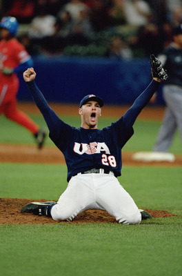 SYDNEY - SEPTEMBER 27:  22-year-old right-handed pitcher Ben Sheets #28 of the USA celebrates after winning the finals game against Cuba at the Baseball Stadium in Olympic Park during the Sydney Olympic Games in Sydney, Australia on September 27, 2000.  T