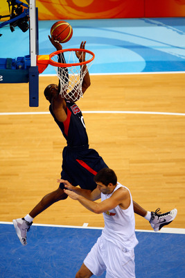 BEIJING - AUGUST 24:  Kobe Bryant #10 of the United States drives to the basket over the defense of Felipe Reyes #9 of Spain in the gold medal game during Day 16 of the Beijing 2008 Olympic Games at the Beijing Olympic Basketball Gymnasium on August 24, 2