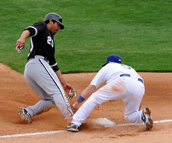 GLENDALE, AZ - MARCH 05:  Carlos Quinten #20 of the Chicago White Sox steals thrid base as Mark Loretta #5 of the Los Angeles Dodgers puts on the tag  during a spring trainning game at Camelback Ranch on March 5, 2009, in Glendale, Arizona. (Photo by Kevo