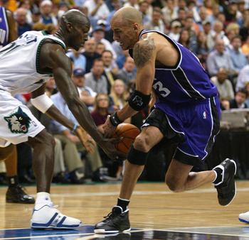 MINNEAPOLIS - MAY 19:  Doug Christie #3 of the Sacramento Kings drives to the net as Kevin Garnett #21 of the Minnesota Timberwolves steals the ball in game seven of the Western Conference Semifinals during the Stanley Cup Playoffs on May 19, 2004 at the