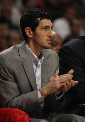 CHICAGO, IL - MAY 02: Injured player Kirk Hinrich of the Atlanta Hawks cheers on his team from the bench against the Chicago Bulls in Game One of the Eastern Conference Semifinals in the 2011 NBA Playoffs at the United Center on May 2, 2011 in Chicago, Il