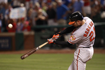 ARLINGTON, TX - JULY 5: Nick Markakis #21 of the Baltimore Orioles flies out to center field against the Texas Rangers at Rangers Ballpark in Arlington on July 5, 2011 in Arlington, Texas. (Photo by Rick Yeatts/Getty Images)