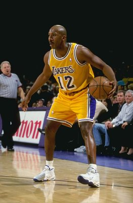 24 Mar 1999:  Derek Harper #12 of the Los Angeles Lakers in action during the game against the Phoenix Suns at the Great Western Forum in Inglewood, California. The Suns defeated the Lakers 106-101.   Mandatory Credit: Todd Warshaw  /Allsport
