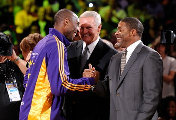 LOS ANGELES, CA - OCTOBER 27:  (L-R) Kobe Bryant #24 of the Los Angeles Lakers is congratulated by former Laker champions Jerry West and Norm Nixon after receiving his 2009 NBA Championship ring before the season opening game against the Los Angeles Clipp