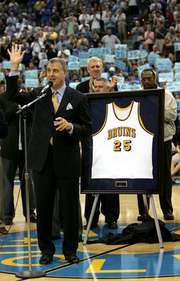 LOS ANGELES, CA - DECEMBER 18:  Former UCLA  player Gail Goodrich waves to the crowd as his jersey is retired during halftime of the game between the UCLA Bruins and the Michigan Wolverines during the game on December 18, 2004 at Pauley Pavilion in Los An