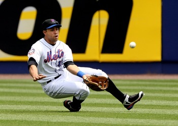 NEW YORK - MAY 15:  Carlos Beltran #15 of the New York Mets makes a diving catch from a ball hit by Cristian Guzman #15 of the Washington Nationals during the first inning on May 15, 2008 at Shea Stadium in the Flushing neighborhood of the Queens borough