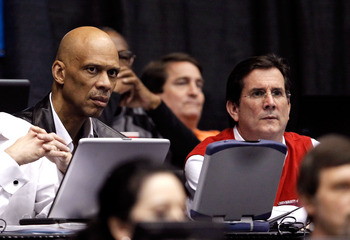 DAYTON, OH - MARCH 15: NBA Hall of Famer Kareem Abdul-Jabbar (L) and University of Dayton President Daniel J. Curran look on during the game between the Arkansas Little Rock Trojans and the North Carolina-Asheville Bulldogs during the first round of the 2
