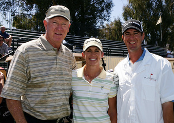 RANCHO MIRAGE, CA - MARCH 28:  Basketball legend John Havlicek poses with LPGA player Nicole Castrale and her husband Craig during the pro-am at the Kraft Nabisco Championship at Mission Hills Country Club on March 28, 2007 in Rancho Mirage, California. (