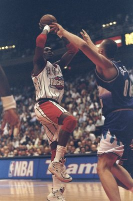 30 Apr 1998: Hakeem Olajuwon #34 of the Houston Rockets in action against Greg Ostertag #00 of the Utah Jazz during the Western Conference First Round Game 3 at the Compaq Center in Houston, Texas. The Rockets defeated the Jazz 89-85.