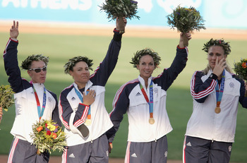 ATHENS - AUGUST 23:  (L-R) Kelly Kretschman, Lisa Fernandez, Leah Amico and Lori Harrigan wave to the crowd after defeating Australia to win the gold medal in the softball gold medal contest on August 23, 2004 during the Athens 2004 Summer Olympic Games a