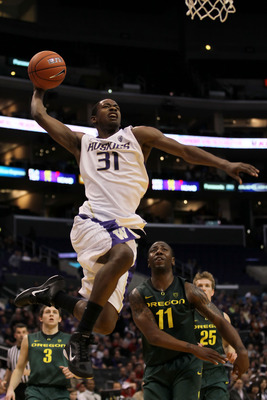 LOS ANGELES, CA - MARCH 11:  Terrence Ross #31 of the Washington Huskies goes up for a dunk late in the second half while taking on the Oregon Ducks in the semifinals of the 2011 Pacific Life Pac-10 Men's Basketball Tournament at Staples Center on March 1