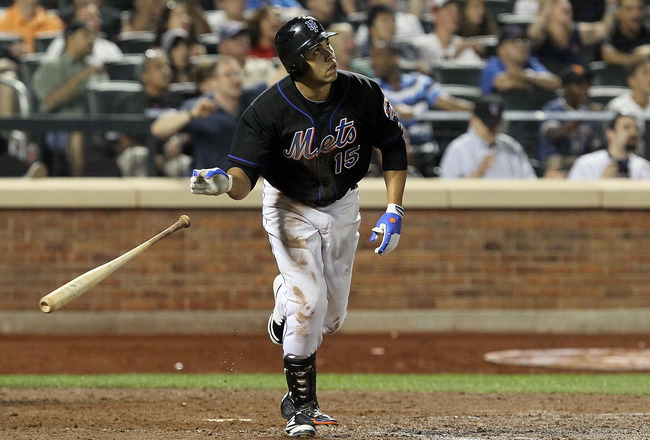 NEW YORK - JULY 31:  Carlos Beltran #15 of the New York Mets hits a game winning walk off sacrifice fly against the Arizona Diamondbacks on July 31, 2010 at Citi Field in the Flushing neighborhood of the Queens borough of New York City. The Mets defeated