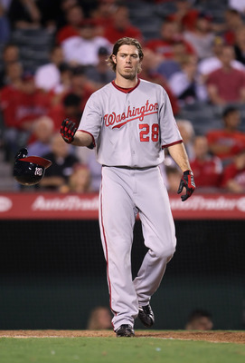 ANAHEIM, CA - JUNE 27:  Jayson Werth #28 of the Washington Nationals tosses his helmet after striking out against the Los Angeles Angels of Anaheim at Angel Stadium of Anaheim on June 27, 2011 in Anaheim, California.  (Photo by Jeff Gross/Getty Images)