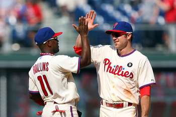 PHILADELPHIA - JULY 10: Shortstop Jimmy Rollins #11 and second baseman Chase Utley #26 of the Philadelphia Phillies high-five after winning a game against the Atlanta Braves at Citizens Bank Park on July 10, 2011 in Philadelphia, Pennsylvania. The Phillie