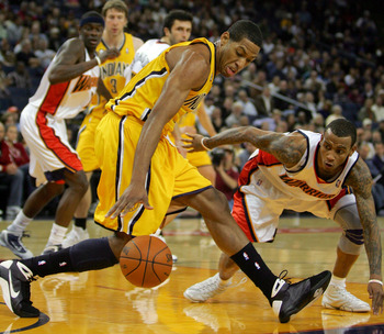 OAKLAND, CA - NOVEMBER 30:  Danny Granger #33 of the Indiana Pacers tries to keep the ball away from Monta Ellis #8 of the Golden State Warriors at Oracle Arena on November 30, 2009 in Oakland, California.  NOTE TO USER: User expressly acknowledges and ag