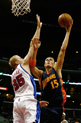 LOS ANGELES, CA - NOVEMBER 15:  Andris Biedrins #15 of the Golden State Warriors drives to the basket over Chris Kaman #35 of the Los Angeles Clippers during the first half at Staples Center on November 15, 2008 in Los Angeles, California. NOTE TO USER: U