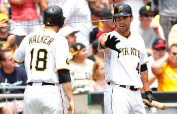 PITTSBURGH - JULY 20:  Garrett Jones #46 of the Pittsburgh Pirates congratulates teammate Neil Walker #18 after scoring against the Cincinnati Reds during the game on July 20, 2011 at PNC Park in Pittsburgh, Pennsylvania.  (Photo by Jared Wickerham/Getty