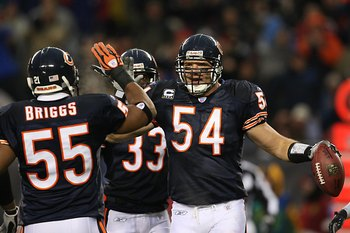 CHICAGO - DECEMBER 2:  Lance Briggs #55 and Brian Urlacher #54 of the Chicago Bears high five each other during the NFL game against the New York Giants at Soldier Field on December 2, 2007 in Chicago, Illinois. (Photo by Jonathan Daniel/Getty Images)