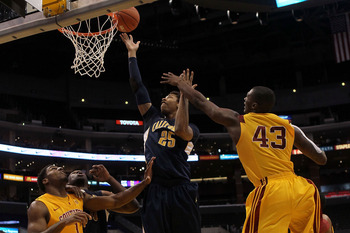 LOS ANGELES, CA - MARCH 10:  Richard Solomon #25 of the California Golden Bears lays the ball up in front of Marcus Simmons #43 of the USC Trojans in the first half of the quarterfinals of the 2011 Pacific Life Pac-10 Men's Basketball Tournament at Staple