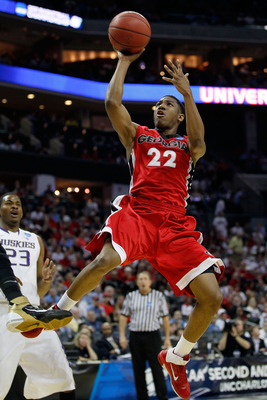 CHARLOTTE, NC - MARCH 18:  Gerald Robinson #22 of the Georgia Bulldogs goes up for a shot in the lane in the first half while taking on the Washington Huskies during the second round of the 2011 NCAA men's basketball tournament at Time Warner Cable Arena