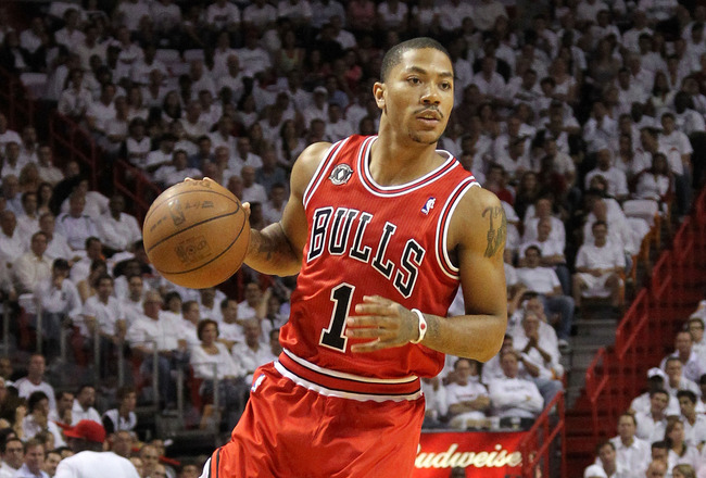 MIAMI, FL - MAY 24:  Derrick Rose #1 of the CHicago Bulls looks to pass against the Miami Heat in Game Four of the Eastern Conference Finals during the 2011 NBA Playoffs on May 24, 2011 at American Airlines Arena in Miami, Florida. NOTE TO USER: User expr