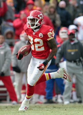 KANSAS CITY, MO - DECEMBER 26:  Receiver Dwayne Bowe #82 of the Kansas City Chiefs carries the ball after making a catch on a 75 yard touchdown play during the game against the Tennessee Titans on December 26, 2010 at Arrowhead Stadium in Kansas City, Mis