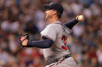 DENVER, CO - JULY 18:  Starting pitcher Derek Lowe #32 of the Atlanta Braves works against the Colorado Rockies at Coors Field on July 18, 2011 in Denver, Colorado. Lowe earned the win as the Braves defeated the Rockies 7-4.  (Photo by Doug Pensinger/Gett