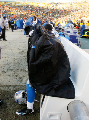 GREEN BAY, WI - DECEMBER 28: Kevin Smith #34 of the Detroit Lions sits on the bench with a coat over him near the end of a game against the Green Bay Packers on December 28, 2008 at Lambeau Field in Green Bay, Wisconsin. The Packers defeated the Lions 31-