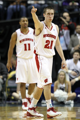 INDIANAPOLIS, IN - MARCH 11:  Josh Gasser #21 of the Wisconsin Badgers gestures on court against the Penn State Nittany Lions during the quarterfinals of the 2011 Big Ten Men's Basketball Tournament at Conseco Fieldhouse on March 11, 2011 in Indianapolis,