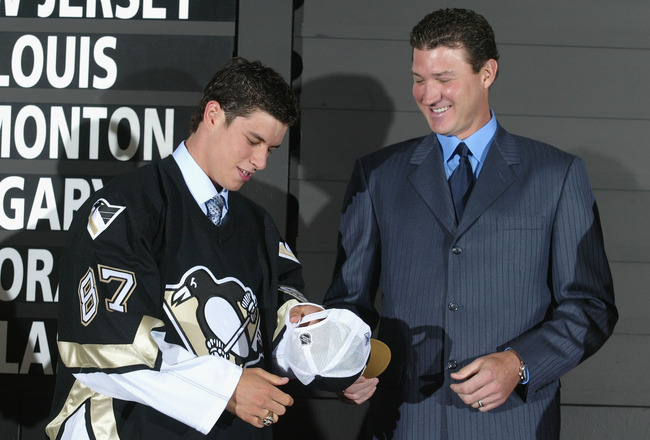 OTTAWA, ONT - JULY 30:  (L-R) First overall draft pick Sidney Crosby accepts a hat and jersey from Mario Lemieux of the Pittsburgh Penguins during the 2005 National Hockey League Draft on July 30, 2005 at the Westin Hotel in Ottawa, Canada.  (Photo by And