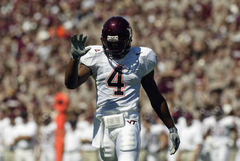 COLLEGE STATION, TX - SEPTEMBER 21:  Cornerback DeAngelo Hall #4 of the Virginia Tech Hokies walks on the field during the NCAA football game against the Texas A&M Aggies on September 21, 2002 at Kyle Field in College Station, Texas. The Hokies won 13-3.