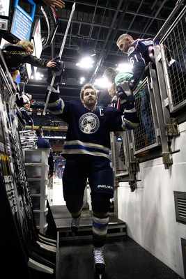 COLUMBUS, OH - JANUARY 14:  Rick Nash #61 of the Columbus Blue Jackets high fives fans after warming up prior to the start of the game against the Detroit Red Wings on January 14, 2011 at Nationwide Arena in Columbus, Ohio. (Photo by John Grieshop/Getty I